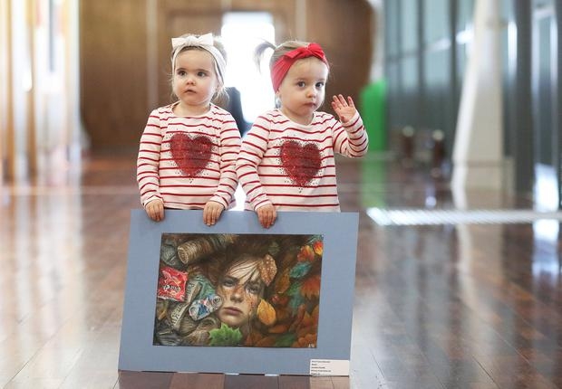 Two-year-old twins Macy and Piper Powell carry Jonathan O'Keeffe's artwork into the gala prize-giving ceremony. Photo: Julien Behal