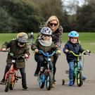 Spring cycle: Corinna Flood from Raheny with her children twins Ben and Louis (5) and Oliver, (3) at St Anne's Park, Raheny, Dublin. Photo: Caroline Quinn