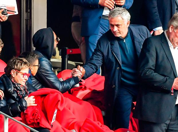French connection: Former Manchester United manager Jose Mourinho shakes hands with Nicolas Anelka at the Ligue 1 clash between Lille and Montpellier yesterday. Photo: Getty Images