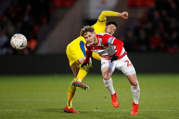 Crystal Palace's Joel Ward in action with Doncaster Rovers' Kieran Sadlier. Photo: Reuters/Carl Recine