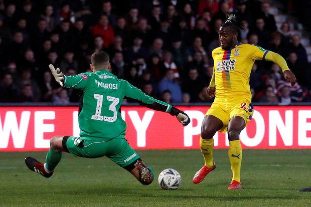 Crystal Palace's Michy Batshuayi in action with Doncaster Rovers' Marko Marosi. Photo; Reuters/Carl Recine