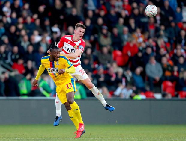 Crystal Palace's Michy Batshuayi (left) and Doncaster Rovers' Paul Downing (right). Photo: Richard Sellers/PA Wire