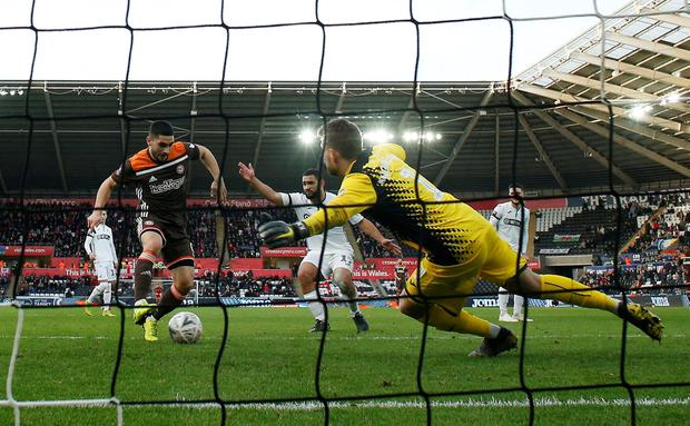 Brentford's Neal Maupay in action with Swansea City's Kristoffer Nordfeldt. Photo: Reuters/Andrew Couldridge