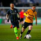 St Padraig's Day: Padraig Amond takes on Nicolas Otamendi during Manchester City's victory in Newportand. Photo: Nick Potts/PA Wire