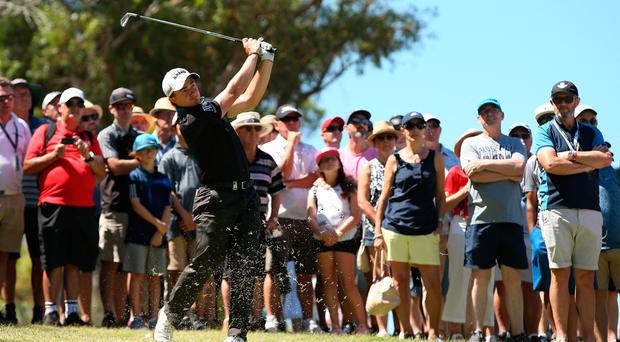 Paul Dunne playing an approach shot during the final day of action at the World Super 6 Perth. Photo by Paul Kane/Getty Images