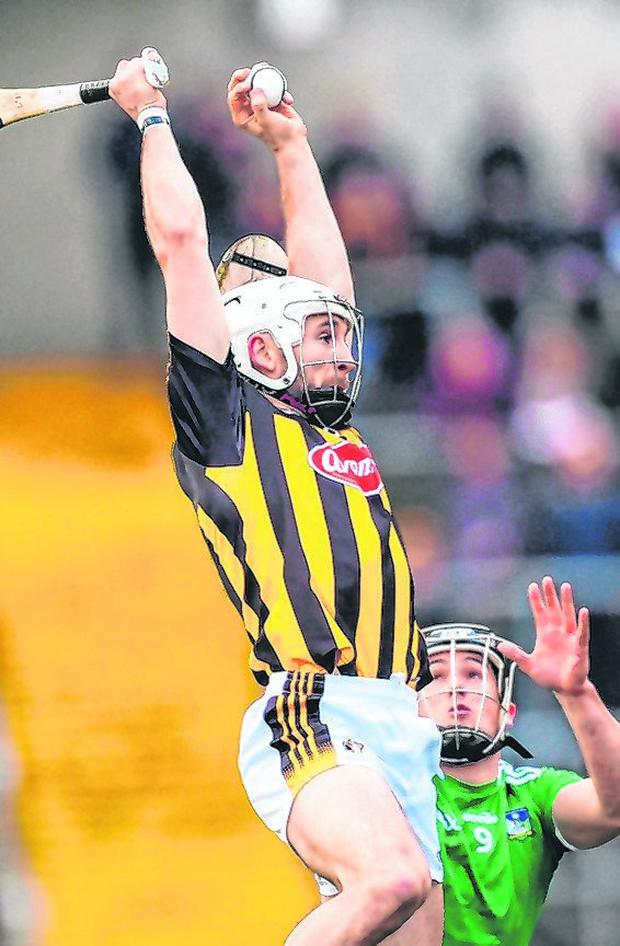 Kilkenny's Conor Fogarty catches the ball over Darragh O'Donovan. Photo by Piaras Ó Mídheach/Sportsfile