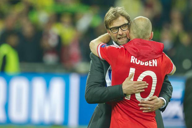 Jurgen Klopp is embraced by Arjen Robben after Bayern Munich's victory over Borussia Dortmund in the 2013 Champions League final. Photo by VI Images via Getty Images