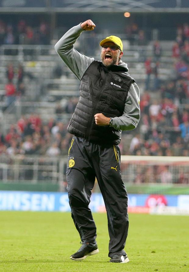 Klopp celebrates the semi-final win over Bayern in the 2015 German Cup. Photo by Christina Pahnke/Sampics/Corbis via Getty Images