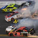 ASCAR Cup Series drivers Ryan Blaney (12), Aric Almirola (10), Paul Menard (21), and driver David Ragan (38), crash during the Daytona 500 at Daytona International Speedway. Credit: Mike DiNovo-USA TODAY Sports