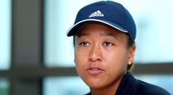 Naomi Osaka of Japan speaks to media during day one of the WTA Dubai Duty Free Tennis Championship at the Dubai Tennis Stadium on February 17, 2019 in Dubai, United Arab Emirates. (Photo by Francois Nel/Getty Images)
