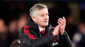 Manchester United caretaker manager Ole Gunnar Solskjaer celebrates victory after the FA Cup fifth round match at Stamford Bridge