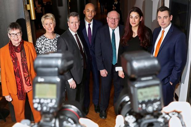 British Labour Party MPs Ann Coffey, Angela Smith, Chris Leslie, Chuka Umunna, Mike Gapes, Luciana Berger and Gavin Shuker pose for a picture after they announced they are leaving the party. Photo: REUTERS/Simon Dawson