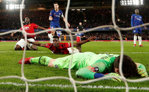 Manchester United's Paul Pogba celebrates scoring their second goal with Romelu Lukaku as Chelsea's Kepa Arrizabalaga looks dejected