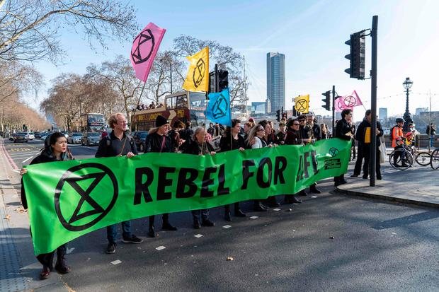 Climate change protesters from the Extinction Rebellion activist group stop traffic in central London as they demonstrate outside the main hub venue of London Fashion Week. Photo: AFP/Getty Images