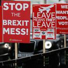 Brexit banners tied onto railings near the Houses of Parliament in London. AP Photo/Kirsty Wigglesworth
