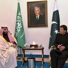 Saudi Arabia's Crown Prince Mohammed bin Salman, left, listens to Pakistani Prime Minister Imran Khan during a meeting in Islamabad. AP photo