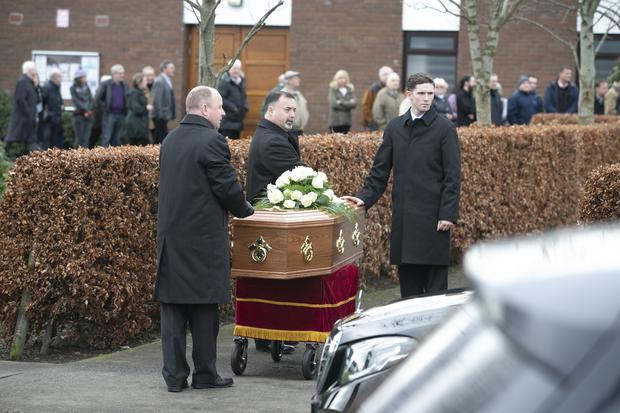 The remains of Patricia Quinn pictured arriving at her Funeral Mass in St Marks Church
