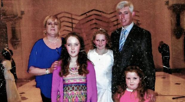 Sheila Tymon, back left, with her husband Michael, and daughters, Rachel, 10, Rebecca, 8, and Katelyn, 5, at Rebecca's First Communion in May 2013, one month before Sheila died.