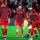 Liverpool's Mohamed Salah (centre) warms up
