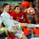 Liverpool's Trent Alexander-Arnold in action with Bayern Munich's Robert Lewandowski