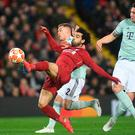 Under pressure from Bayern Munich's Joshua Kimmich, Mo Salah is off target with a first-half chance at Anfield last night. Photo: AFP/Getty Images