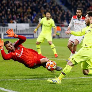 Lyon's Anthony Lopes dives to save a shot from Lionel Messi. Photo: REUTERS/Emmanuel Foudrot