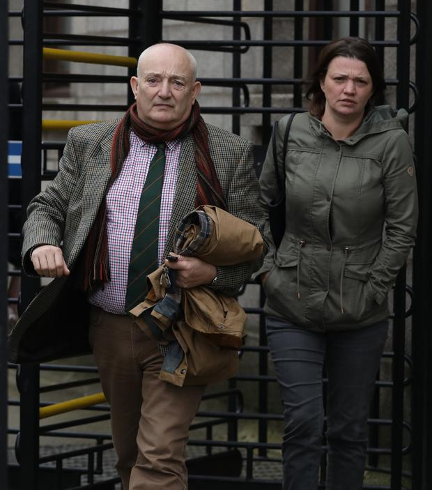 Damages: Grandfather Brian Johnson and mother Jill Johnson-Rice outside the Four Courts. Photo: Collins