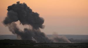 Smoke rises from inside the village of Baghouz, in this photo taken near Baghouz, in Deir Al Zor province, Syria. Photo: REUTERS/Rodi Said