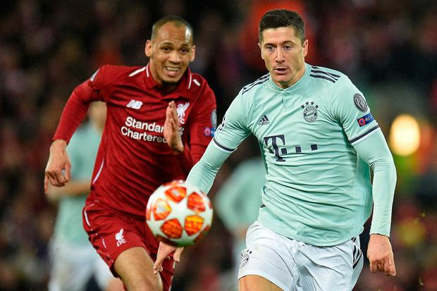 Bayern Munich's Robert Lewandowski (R) and Liverpool's Fabinho