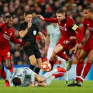 Liverpool's Joel Matip, Jordan Henderson and Naby Keita in action with Bayern Munich's Robert Lewandowski REUTERS/Phil Noble