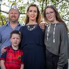 Vicky Phelan pictured with her husband Jim and children Amelia and Darragh Photo: Fergal Phillips