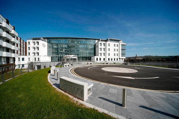 The woman was brought to Cork University Hospital after being found on the side of the road