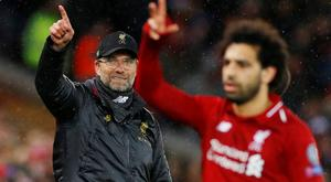 Liverpool manager Jurgen Klopp and Liverpool's Mohamed Salah gesture during the match. REUTERS/Phil Noble