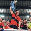UCC captain Cian Kiely lifts the Sigerson Cup aloft after his side's victory over St Mary's, Belfast. Photo: Piaras Ó Mídheach/Sportsfile