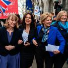 Breakaway: Ex-Labour MP Joan Ryan (left) links arms with former Tory MPs Heidi Allen, Anna Soubry and Sarah Wollaston who quit the party yesterday. Photo: Chris J Ratcliffe/Getty