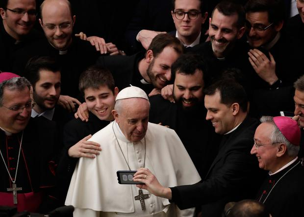 Controversy: Pope Francis poses for a photo with a group of priests at the end of his weekly general audience in the Vatican. Photo: AP Photo/Alessandra Tarantino
