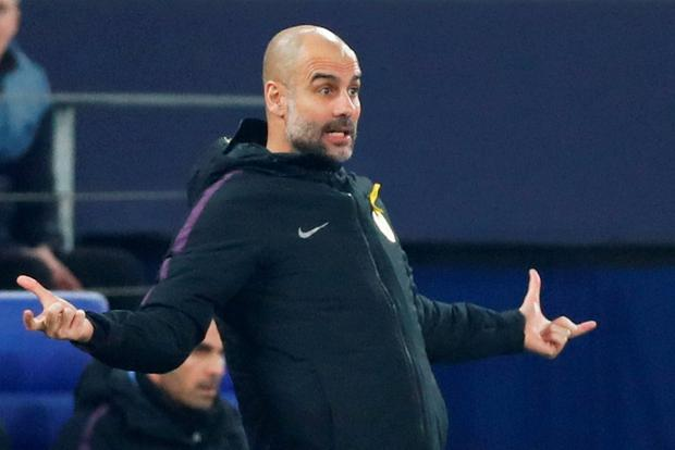 Manchester City manager Pep Guardiola reacts against Schalke