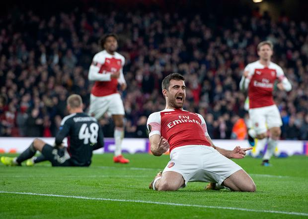 Sokratis Papastathopoulos of Arsenal celebrates after scoring during the UEFA Europa League Round of 32 Second Leg match between Arsenal and BATE Borisov at Emirates Stadium (Photo by TF-Images/TF-Images via Getty Images)