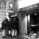 Destruction: firefighters at the scene of the blast at the Tavern in the Town