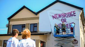 Kildare supporters watch a mural being painted outside St Conleth's Park last June – if Motion 11 passes, the CCCC would have greater power to avoid another 'Newbridge or Nowhere' controversy. Photo: Sportsfile