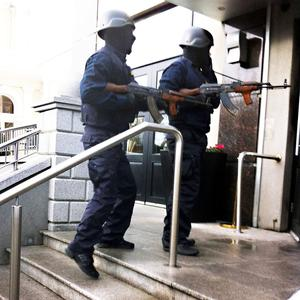 Entrance: Raiders disguised as gardaí armed with AK47 assault rifles enter the front door of the Regency Hotel
