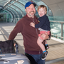 Keep smiling: Canadian Phil O'Connor, who lives in Dublin, and his son Stephen (2) keep up their spirits at the airport after his flight was delayed. Photo: Mark Condren