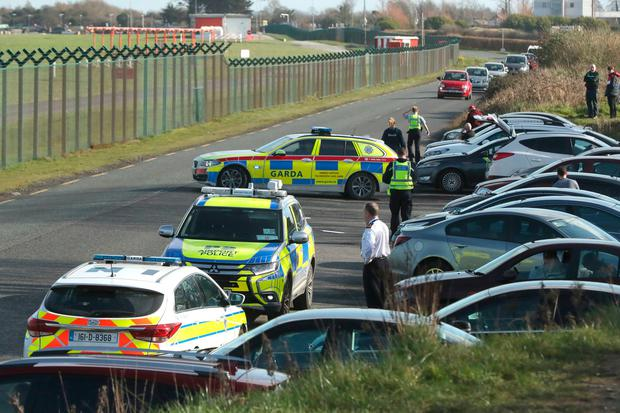 Alert: Airport police at a site popular with plane spotters after a drone sighting at Dublin Airport. Photo: PA Wire