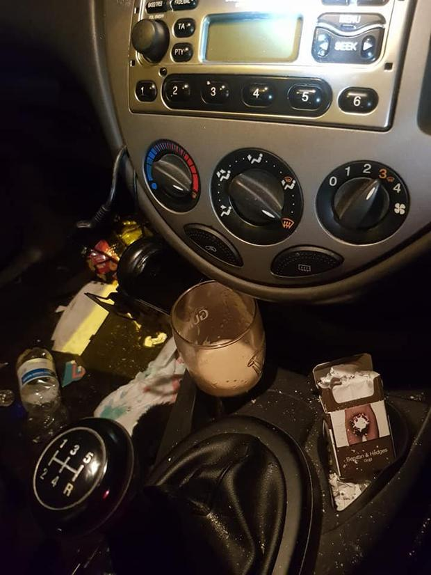 A pint glass was discovered by the driver's seat