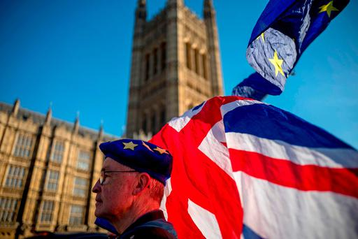 Thinking cap: An anti-Brexit protester outside the Houses of Parliament in London. Photo: Getty Images