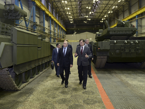 Weapons: Russian President Vladimir Putin, left, inspects battle tanks in the Urals city of Nizhny Tagil, Russia.