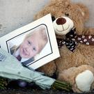 File photo dated 4/7/2018 of a picture among tributes near a house on Ardbeg Road on the Isle of Bute in Scotland, after the body of Alesha MacPhail was found in woodland on the site of a former hotel by a member of the public. Photo: John Linton/PA Wire