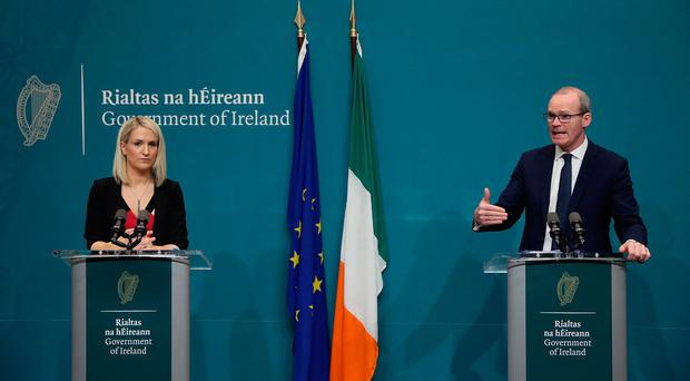 Tanaiste Simon Coveney (right) and Minister of State for European Affairs Helen McEntee at a press conference at Government Buildings in Dublin. Photo: Brian Lawless/PA Wire