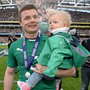 Ireland's Brian O'Driscoll with his daughter Sadie after Italy match in 2014