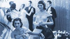 Lee and Jackie - then the Bouvier sisters - at a debutantes' ball in 1951